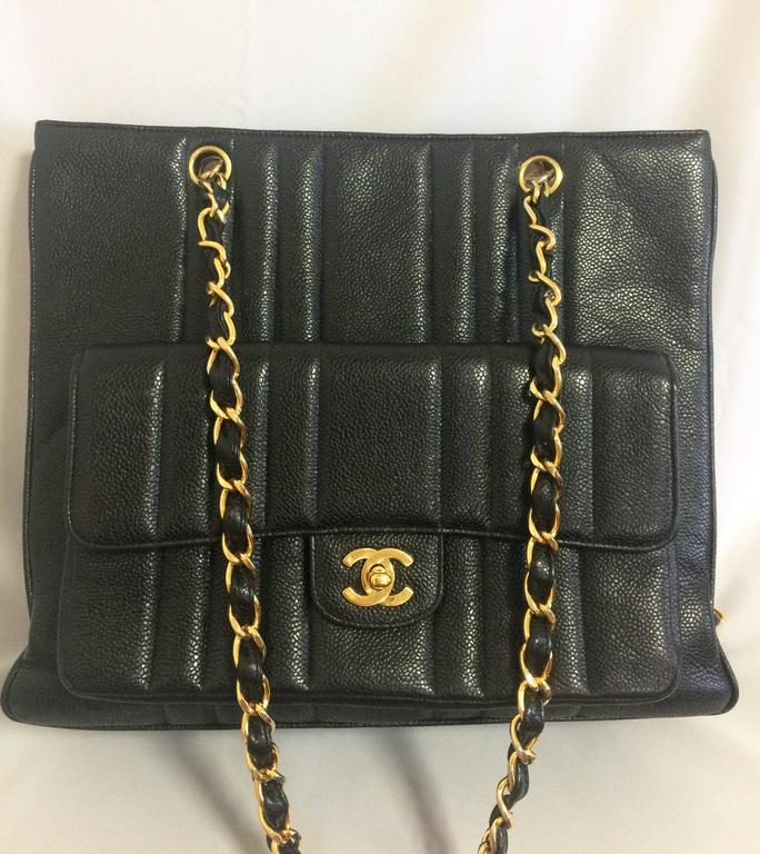 1990s. Vintage CHANEL rare 2.55 combo design black caviar leather chain shoulder bag with vertical stiches and golden CC closure hock at front pocket.  Beautiful vintage condition! Introducing another unique vintage Chanel bag back in the approx mid