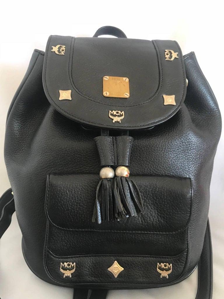 MCM Vintage Mcm Black Backpack With Golden Studded Logos. Designed By Michael Cromer O58nM