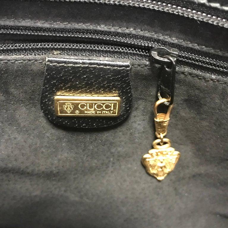 Vintage Gucci black pigskin large trapezoid shape shoulder bag with embossed GG. For Sale 4