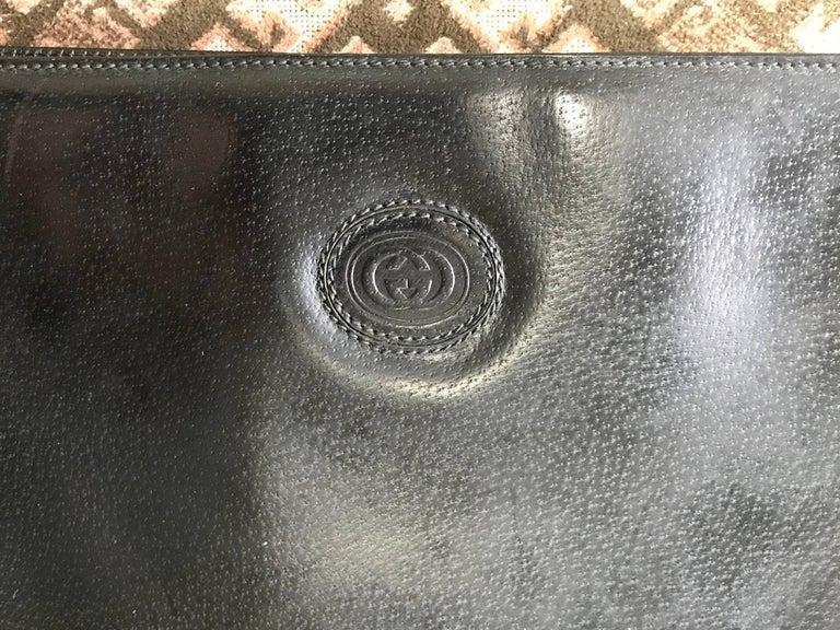 Black Vintage Gucci black pigskin large trapezoid shape shoulder bag with embossed GG. For Sale
