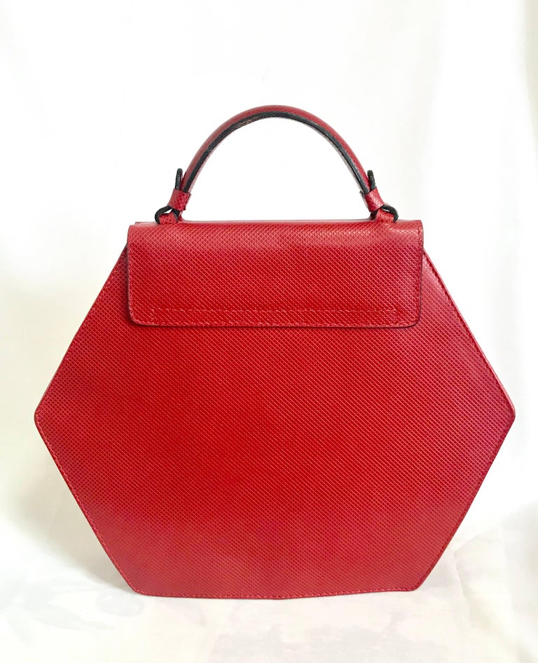 1990s. Vintage Bottega Veneta grained red leather hexagon shape handbag with golden hardware. Rare purse. Introducing another cutest and rare vintage purse from Bottega Veneta.  Grained red leather handbag in unique hexagon shape!  One-of-a-kind