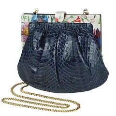 1980s. Vintage Gucci genuine navy snakeskin clutch bag with floral frames.