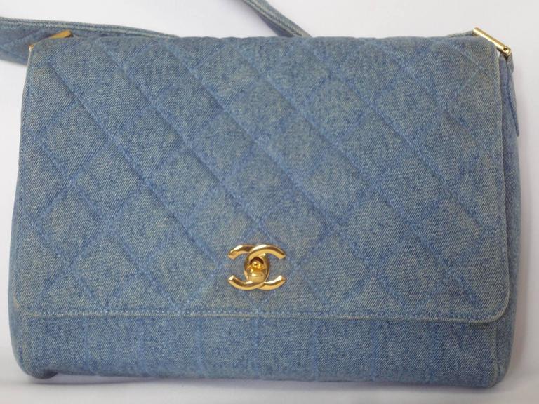 This Is A Vintage Chanel Denim Shoulder Bag Handbag With Vertical Sches And Golden Cc