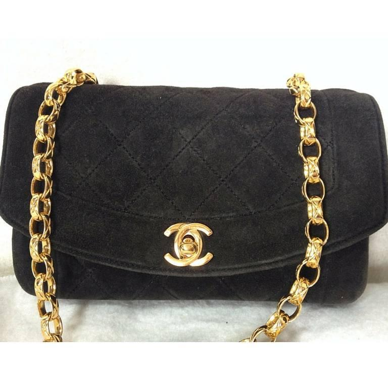 Vintage CHANEL charcoal black suede leather classic 2.55 shoulder purse with gold tone chain straps. Perfect daily use bag.  This is a vintage purse with gold chain strap from Chanel from the 90s. Classic charcoal black suede leather classic 2.55
