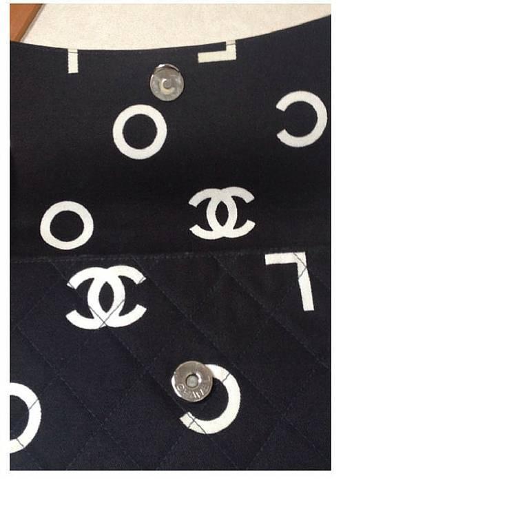 Vintage CHANEL black fabric canvas chain handbag with white Chanel cc logo print 4