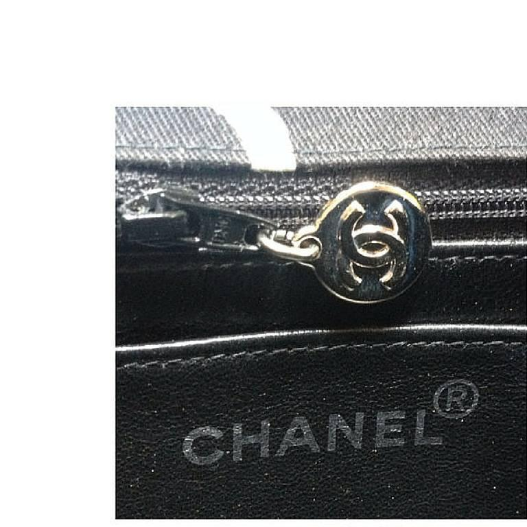 Vintage CHANEL black fabric canvas chain handbag with white Chanel cc logo print For Sale 1