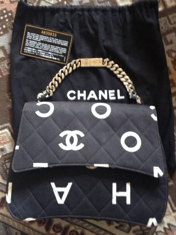 Vintage CHANEL black fabric canvas chain handbag with white Chanel cc logo print For Sale 4