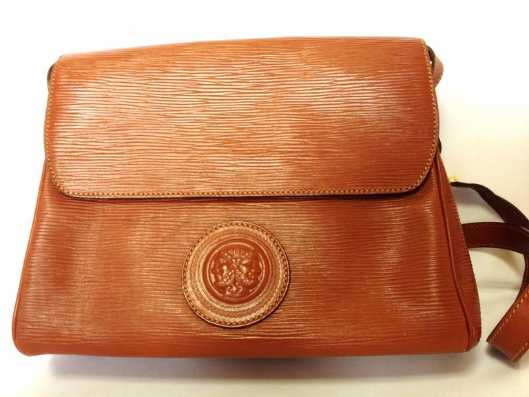 Vintage FENDI brown epi leather messenger bag, shoulder purse with iconic logo embossed motif at front. Unisex. Rare bag.  If you are a FENDI vintage collector and lover, then this one will be your must-have piece.  This is a vintage