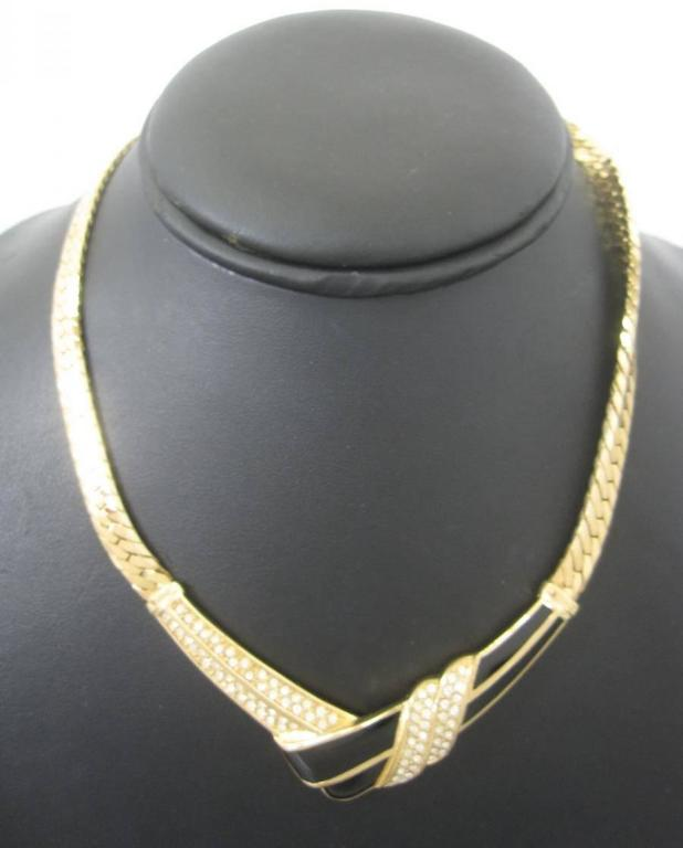MINT. Vintage Christian Dior thick golden chain tie knot design statement necklace with black and clear rhinestone crystal stones.