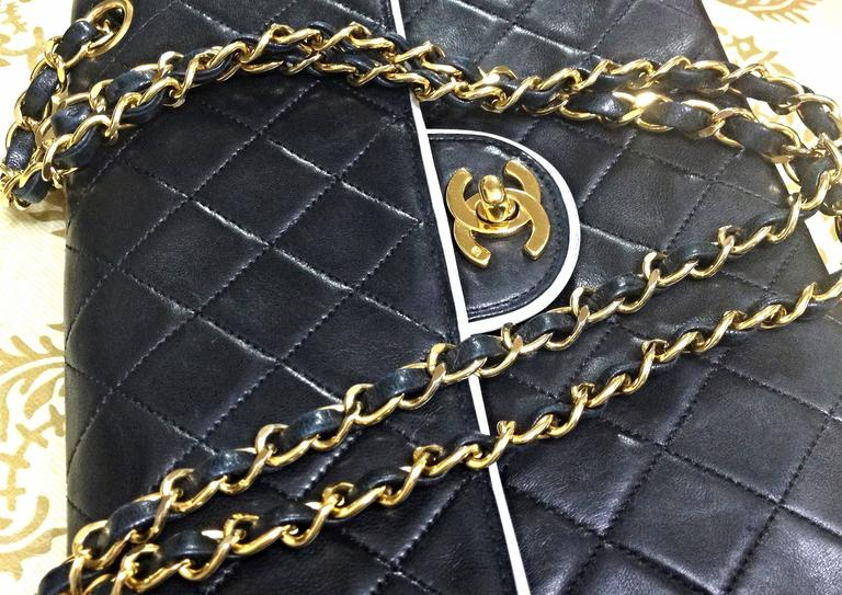 Black Vintage Chanel black and white lambskin 2.55 shoulder bag with golden chains For Sale
