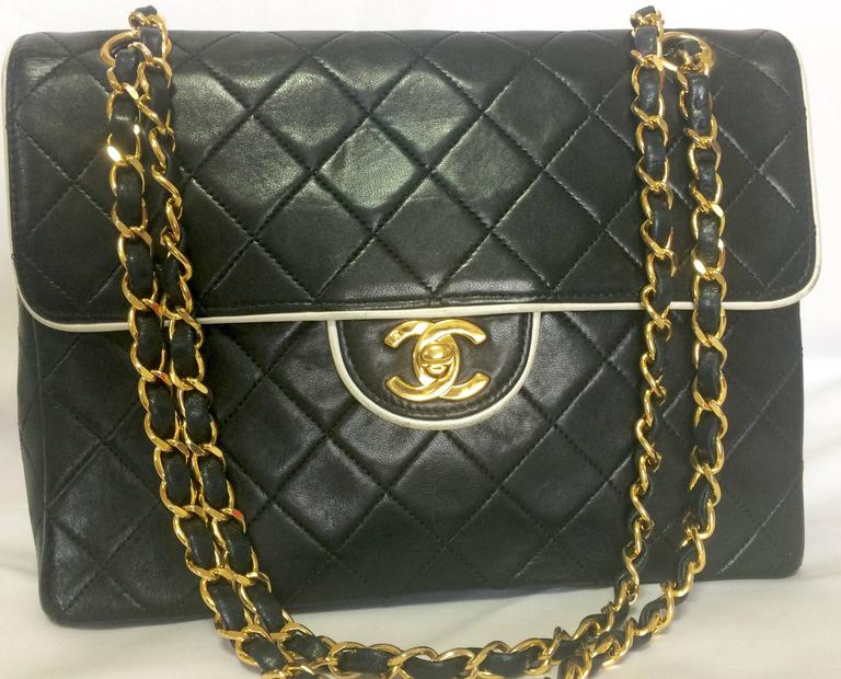 1990s. Vintage Chanel black lambskin 2.55 classic shoulder bag with gold chain and cc closure. Unique white edge design. If you are a vintage CHANEL lover/collector, then this is a must-have piece for your collection! Introducing a very rare vintage