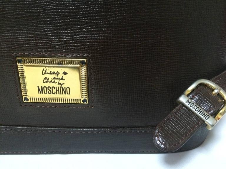 Women's Vintage MOSCHINO dark brown leather backpack with golden and black M logo. For Sale