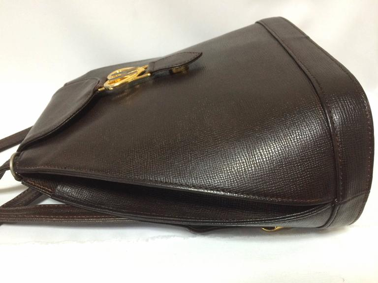 Vintage MOSCHINO dark brown leather backpack with golden and black M logo. For Sale 2