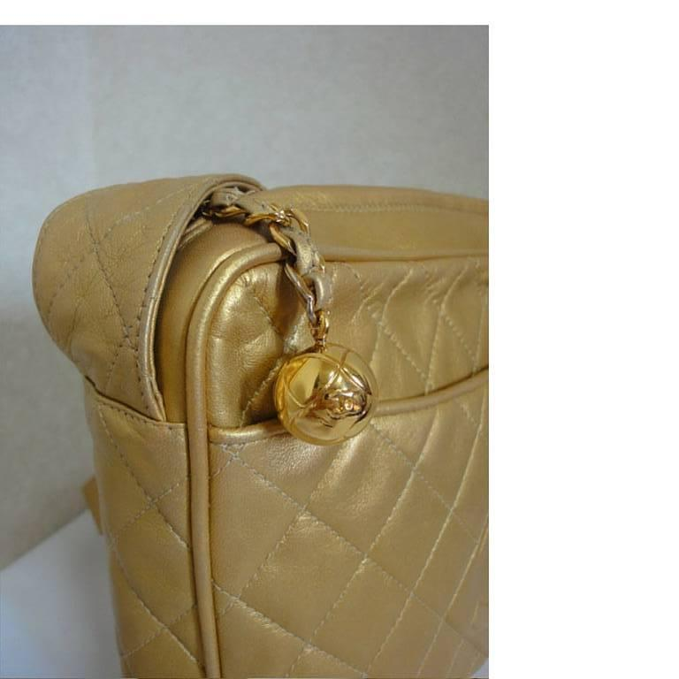 Vintage CHANEL golden lamb leather shoulder bag with CC mark and cc charm. 7