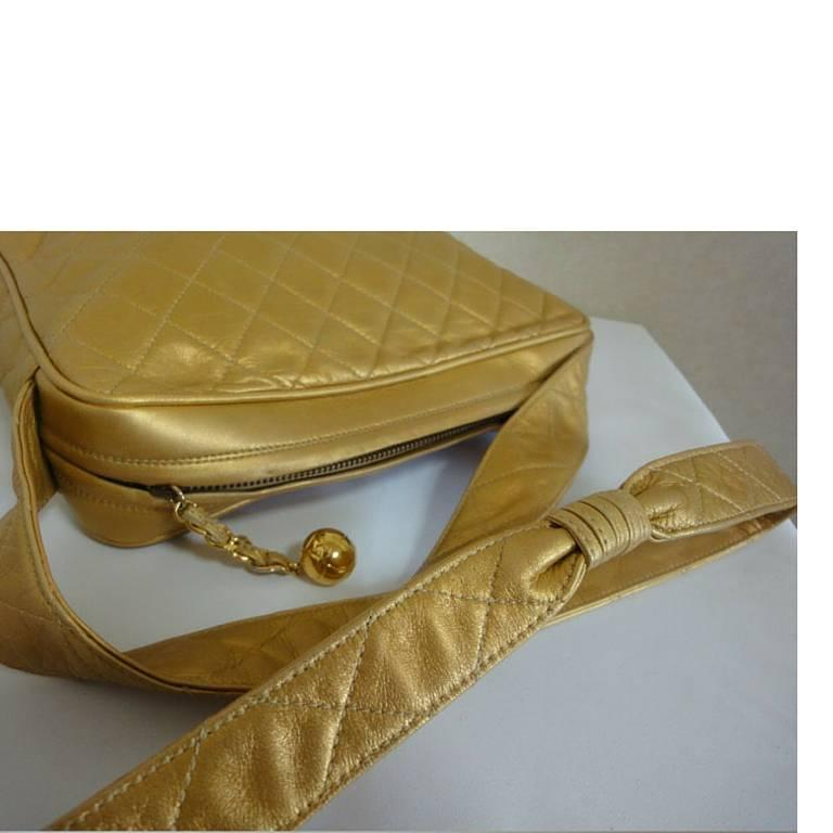 Vintage CHANEL golden lamb leather shoulder bag with CC mark and cc charm. 6