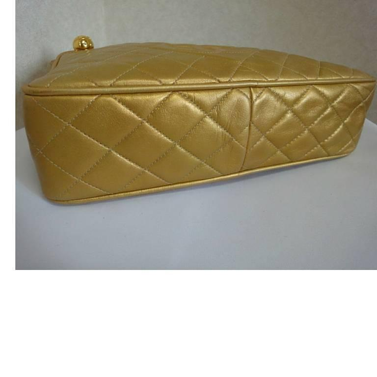Vintage CHANEL golden lamb leather shoulder bag with CC mark and cc charm. 5