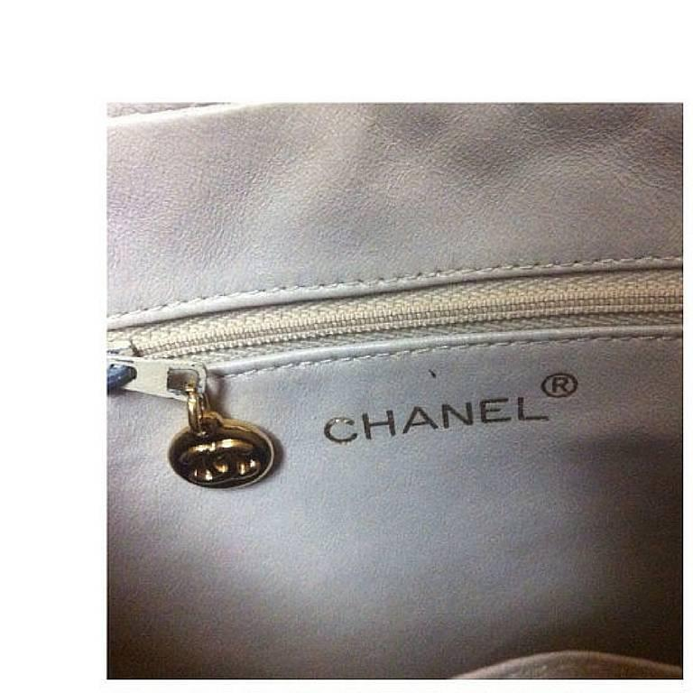 Vintage CHANEL golden lamb leather shoulder bag with CC mark and cc charm. 9