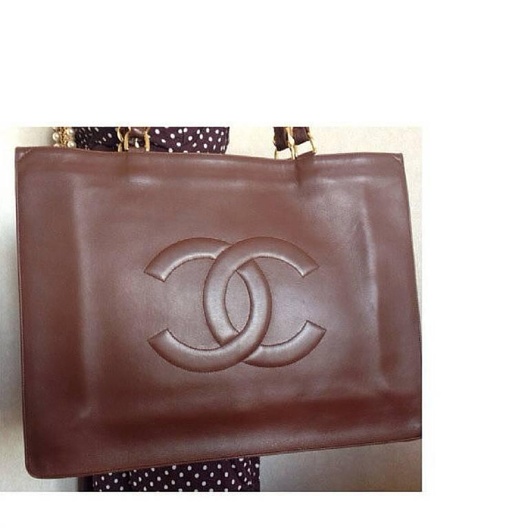 Vintage CHANEL brown calfskin large tote bag with gold tone chain handles and CC 2