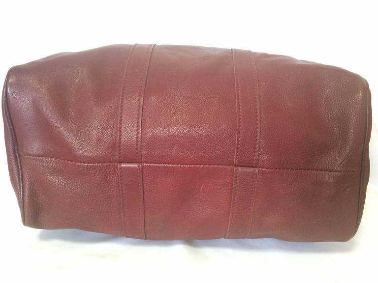 Women's or Men's 80's Vintage Longchamp rare dark wine leather duffle bag, mini travel purse.  For Sale