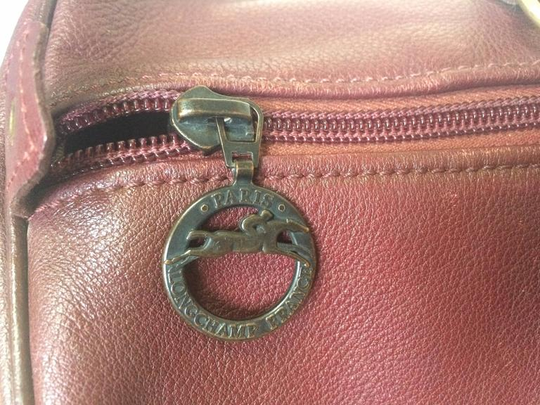 80's Vintage Longchamp rare dark wine leather duffle bag, mini travel purse.  For Sale 1