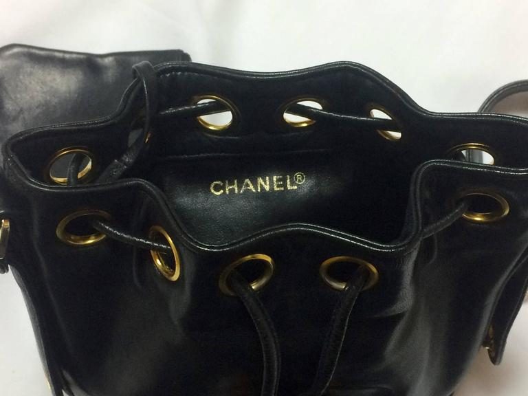 Vintage CHANEL black lamb leather mini hobo bucket drawstring shoulder bag. For Sale 3