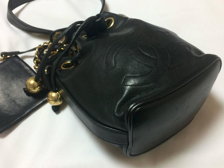 Women's Vintage CHANEL black lamb leather mini hobo bucket drawstring shoulder bag. For Sale