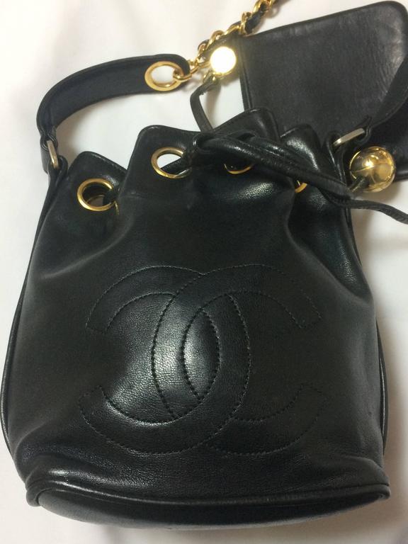 Black Vintage CHANEL black lamb leather mini hobo bucket drawstring shoulder bag. For Sale