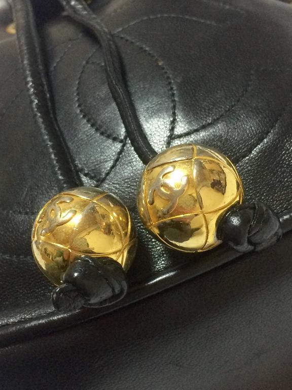 Vintage CHANEL black lamb leather mini hobo bucket drawstring shoulder bag. For Sale 1