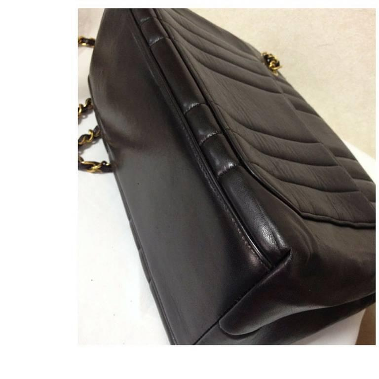 Vintage CHANEL black lambskin chain shoulder bag in vertical stitch, flower cc 4