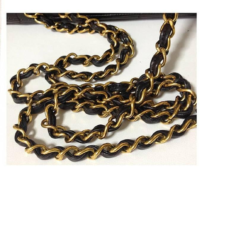 Vintage CHANEL black lambskin chain shoulder bag in vertical stitch, flower cc 9