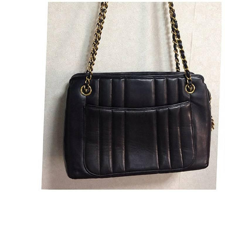 Vintage CHANEL black lambskin chain shoulder bag in vertical ...