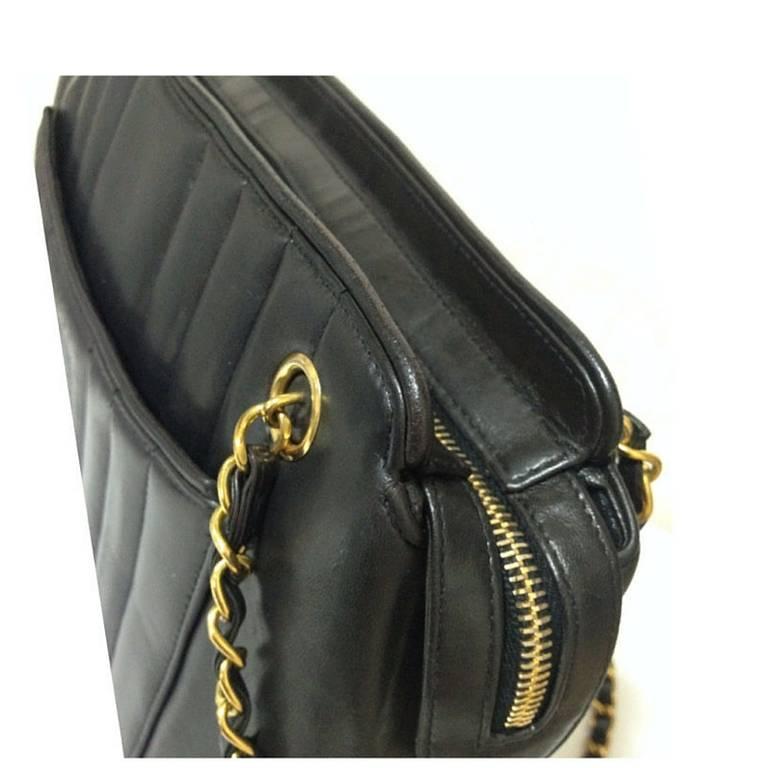 Vintage CHANEL black lambskin chain shoulder bag in vertical stitch, flower cc 6