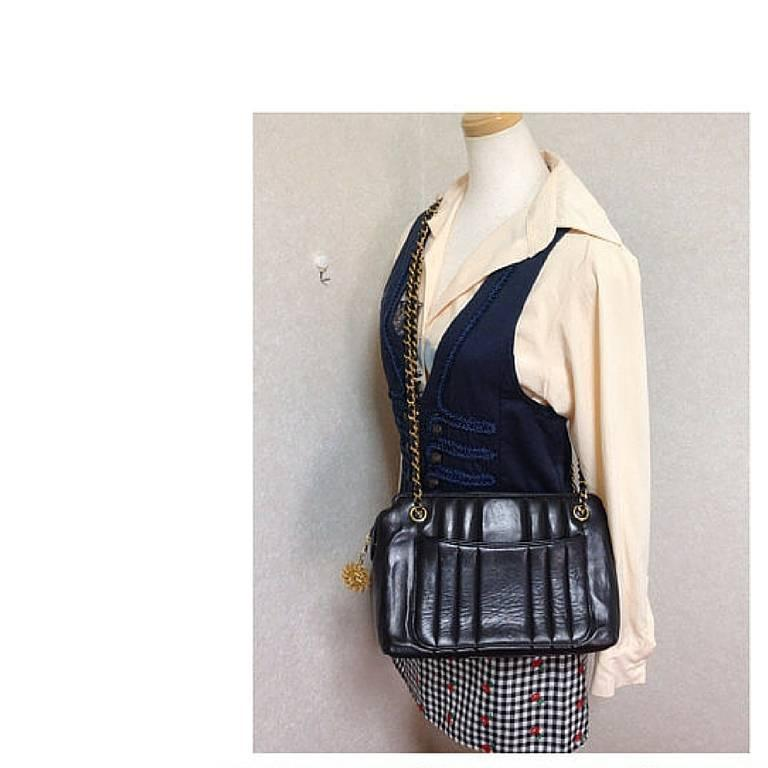 Vintage CHANEL black lambskin chain shoulder bag in vertical stitch, flower cc 10