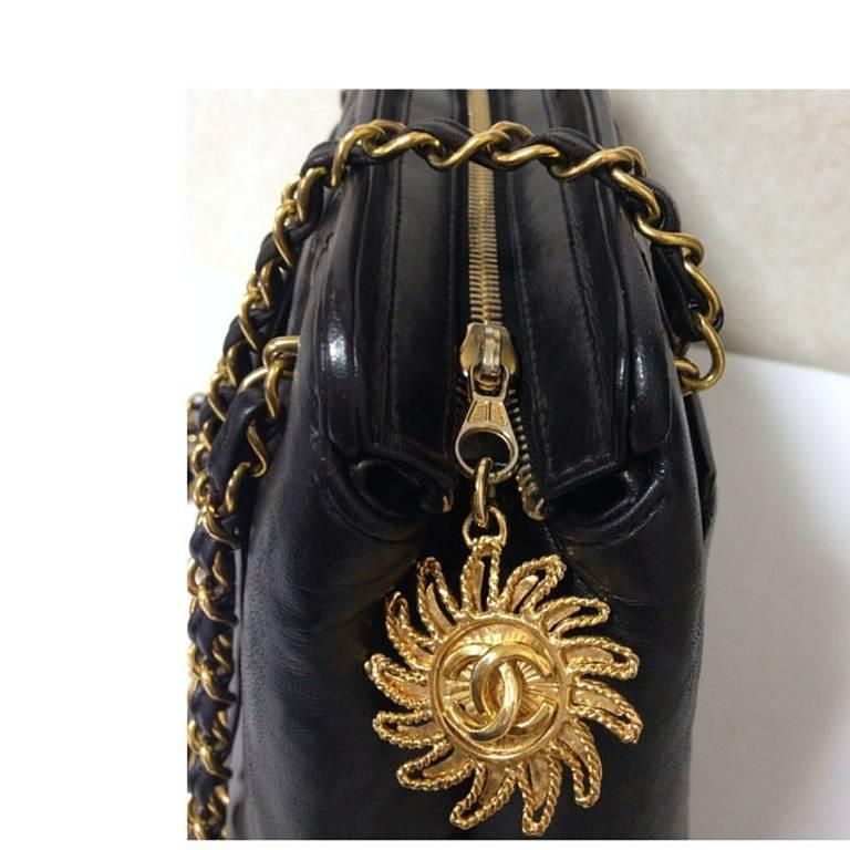 Vintage CHANEL black lambskin chain shoulder bag in vertical stitch, flower cc 3