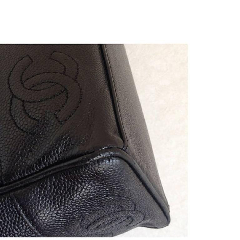 Vintage CHANEL black caviar leather shoulder tote bag with cc stitch marks. 5