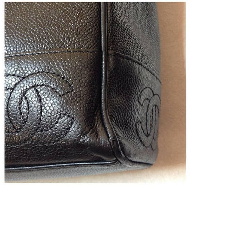 Vintage CHANEL black caviar leather shoulder tote bag with cc stitch marks. 4