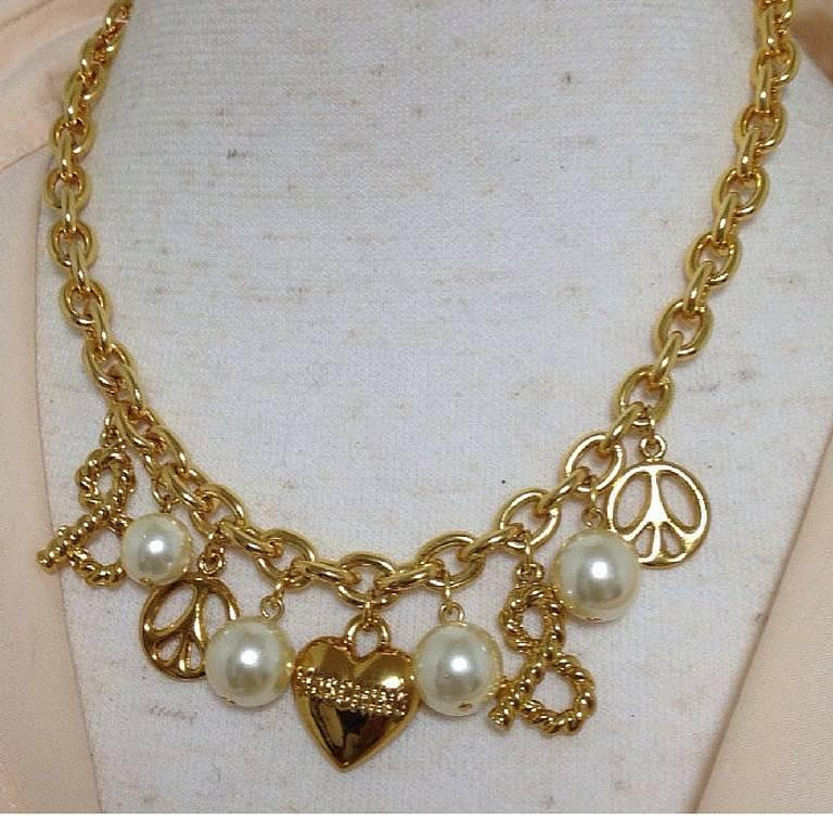 MINT. Vintage Moschino statement necklace with heart, peace mark, faux pearls.  2