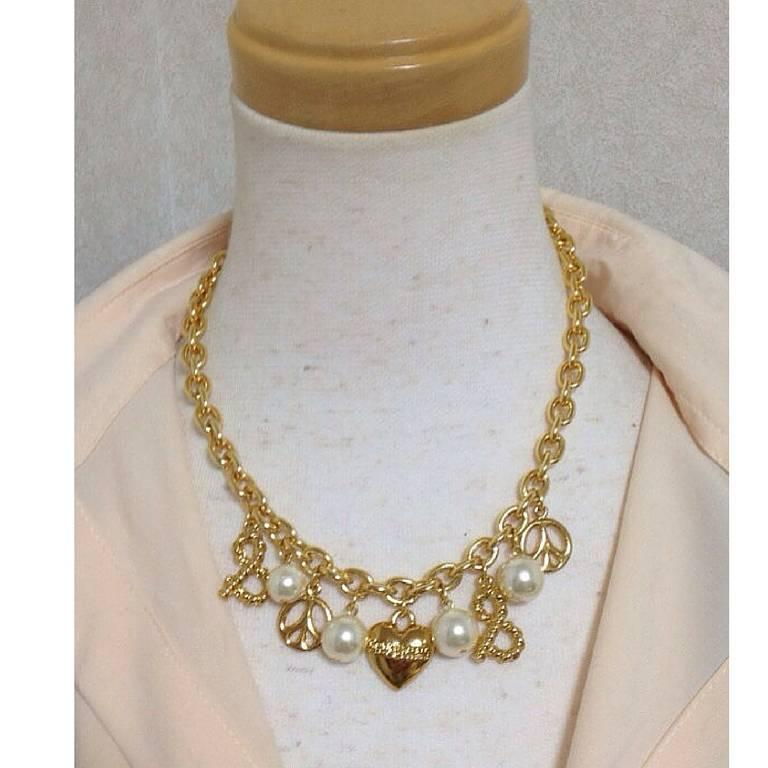 MINT. Vintage Moschino statement necklace with heart, peace mark, faux pearls.  5