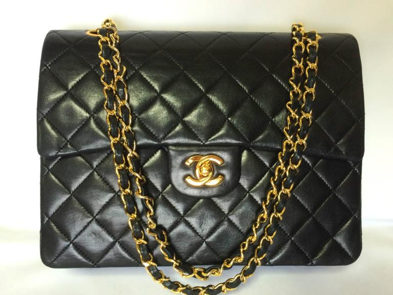 Vintage CHANEL black lambskin classic 2.55 double flap shoulder bag with cc 2