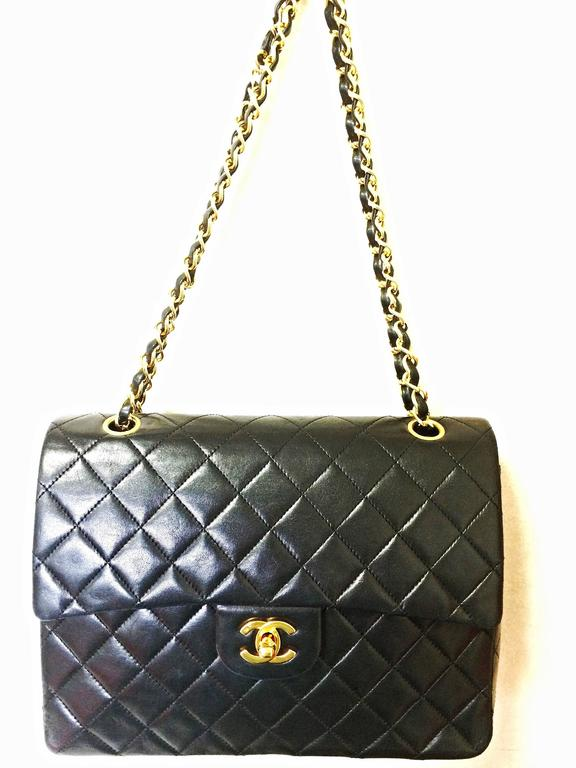 Vintage CHANEL black lambskin classic 2.55 double flap shoulder bag with cc 10