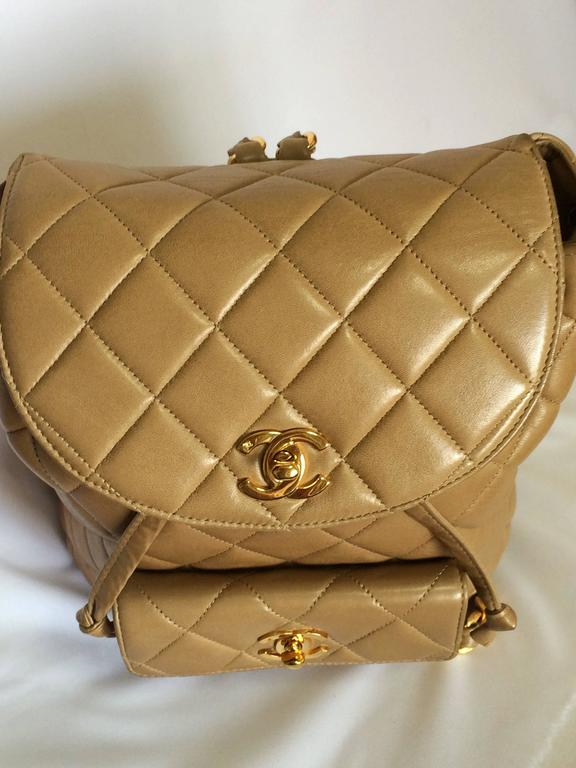 Vintage CHANEL brown beige lambskin backpack with golden ...