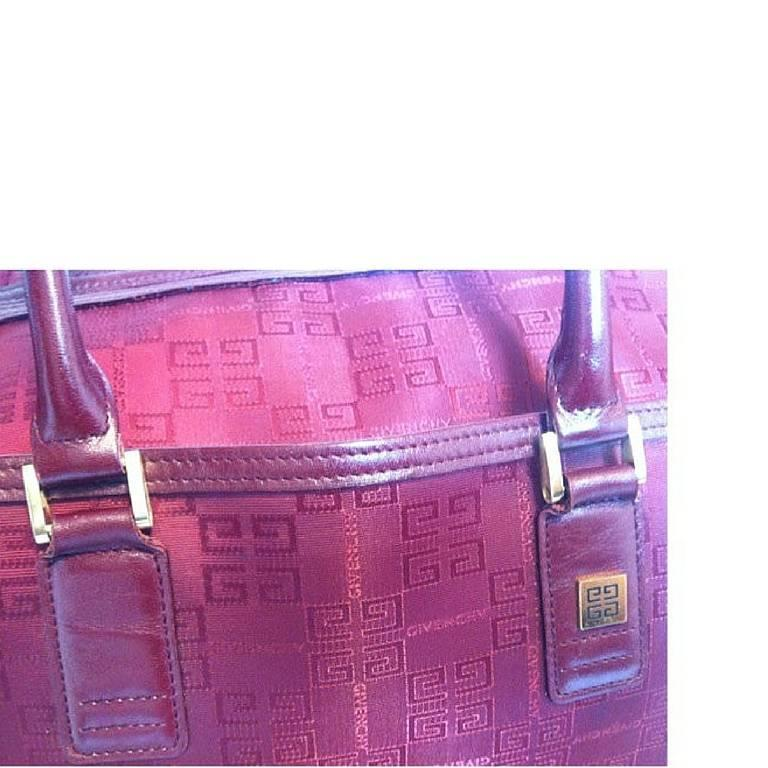 vintage givenchy travel duffle bag in logo jacquard wine color fabric  unisex at 1stdibs