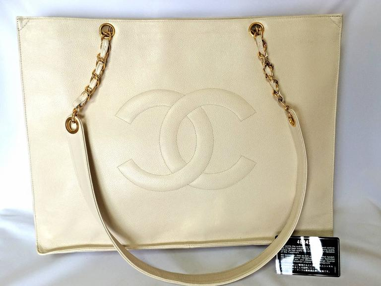 1990s. Vintage CHANEL ivory white color caviar leather large tote bag, shopper with gold-tone chains and large CC stitch mark. Perfect daily bag.
