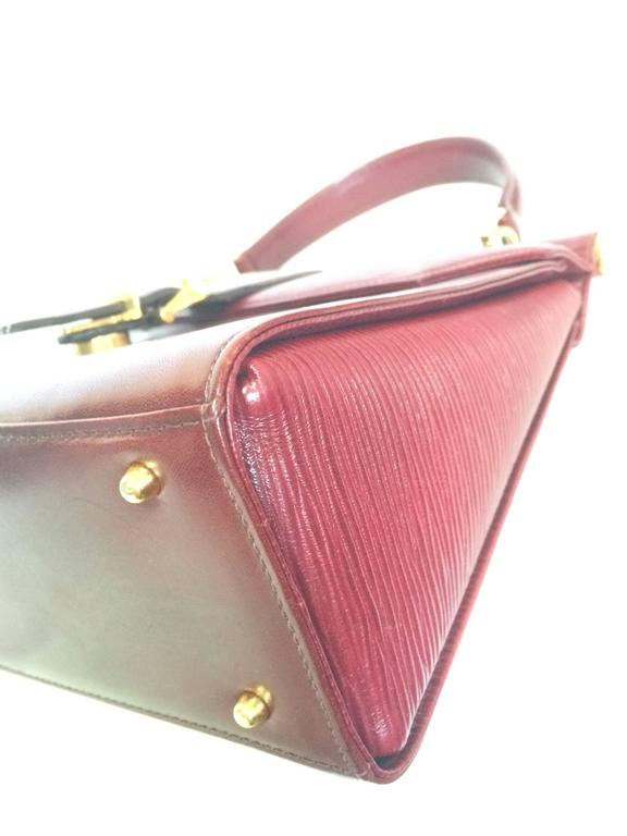 Vintage Valentino Garavani wine epi and smooth leather handbag with buckle flap. 7