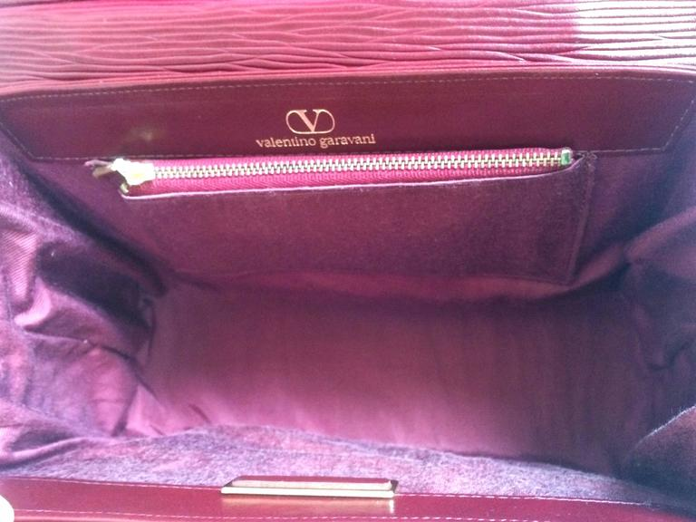 Vintage Valentino Garavani wine epi and smooth leather handbag with buckle flap. 8