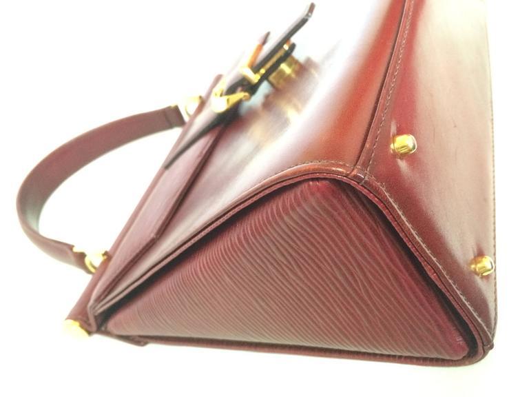Vintage Valentino Garavani wine epi and smooth leather handbag with buckle flap. 6