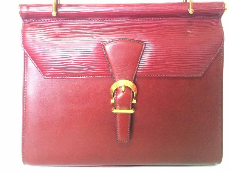 Vintage Valentino Garavani wine epi and smooth leather handbag with buckle flap. 2