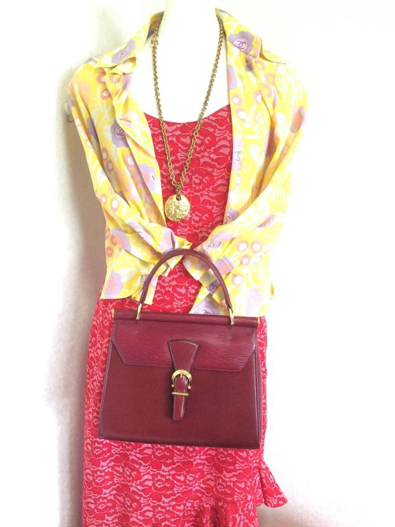Vintage Valentino Garavani wine epi and smooth leather handbag with buckle flap. 10