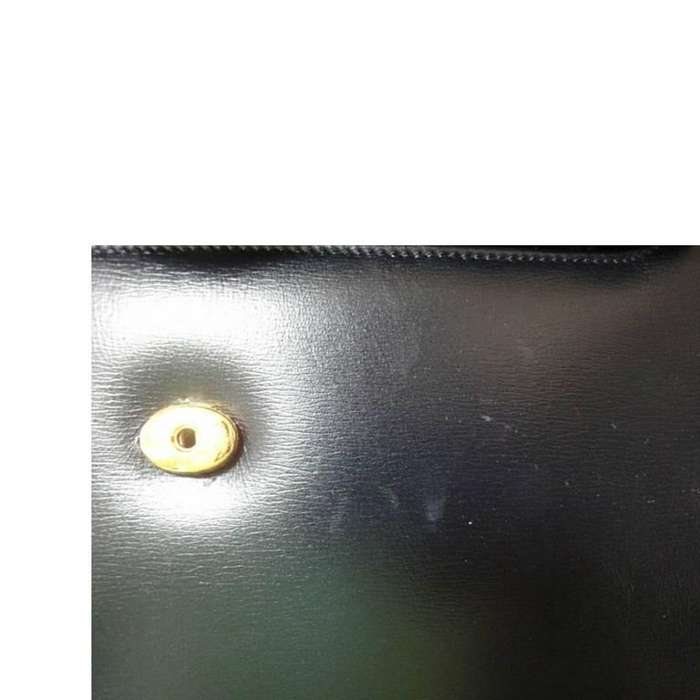 Vintage Cartier black navy  leather classic shape clutch bag with blue stone. For Sale 3