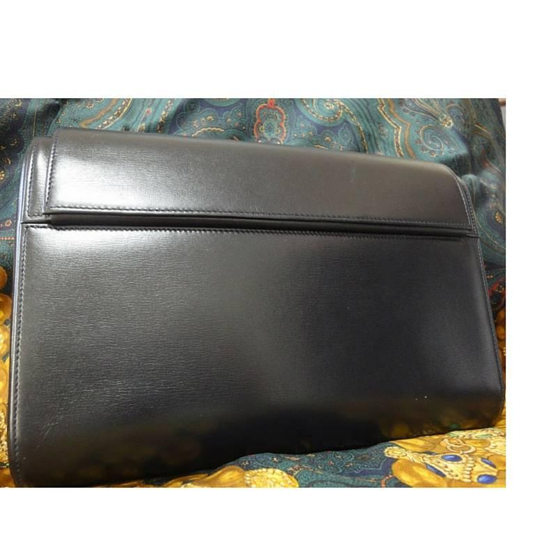 Black Vintage Cartier black navy  leather classic shape clutch bag with blue stone. For Sale